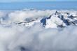 Winter mountain snowy peaks over the clouds in the valley. Jungfrau region in Switzerland. - 232475920