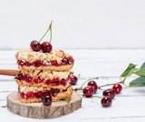 stack of baked cake with cherry berries