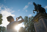 Woman photographs a monument to Peter the first in Saint-Petersburg. - 232486194