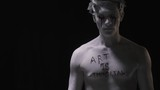 Vandalism, Statue with bloody tears and writing on his chest - 232486737