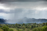 Localized rain storm pouring rain over the Ethiopian landscape. - 232487355