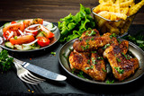 Roast chicken wings with french fries and vegetable salad  - 232504336