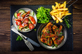 Roast chicken wings with french fries and vegetable salad  - 232504522