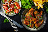 Roast chicken wings with french fries and vegetable salad  - 232504579