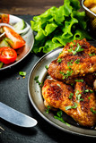 Roast chicken wings with french fries and vegetable salad  - 232504757