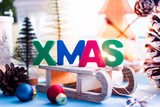 Christmas background - wooden sleds on which large colored letters with the letter