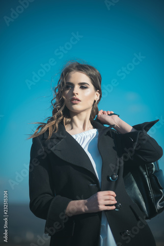 Leinwandbild Motiv Beauty and fashion look. Pretty girl with fashionable hair. Fashion woman with stylish makeup and curly hair. autumn fashion of business woman with bag. Funky style beauty. She is really cute