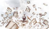 Young businessman or student studying the science and books fly  - 232539580