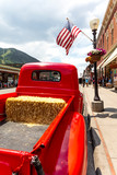 July 4, 2018 - Annual  Independence Day Parade, Telluride, Colorado Colorado Avenue - ffeatures vintage Ford Red Pickup Truck