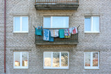 clothes drying on the balcony of the facade of a residential building in the sleeping area - 232554146