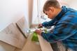 Man measuring and marking laminate floor tile for cutting, installing laminate flooring. - 232559334
