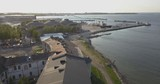 Aerial view flying above a a prison row on the shore of the Baltic sea in Tallinn, Estonia - 232575778
