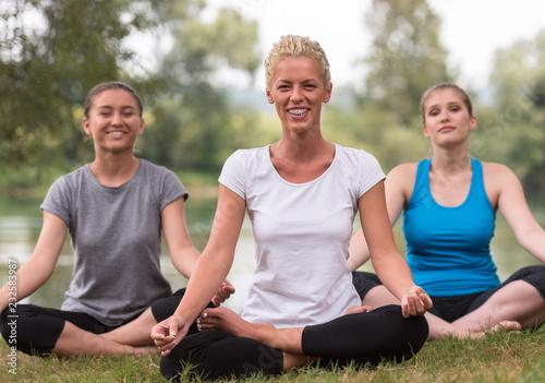Leinwanddruck Bild women meditating and doing yoga exercise