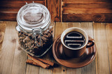 Cup of hot coffee and coffee beans - 232593166