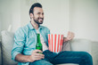 Leinwanddruck Bild - Positive cheerful handsome bearded man with snack and refreshmen