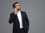 Young businessman speaking on phone - 232613150