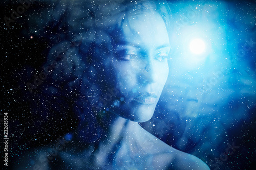 Silhouette of woman on space background. © eevl