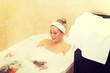 Leinwanddruck Bild - Young woman relaxing in bath