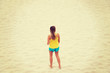 Leinwanddruck Bild - Tired woman standing on the beach