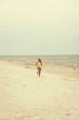 Leinwanddruck Bild - Young woman running on the beach