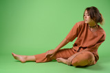 Studio shot of young beautiful woman against green background - 232623534