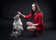 Girls in red dresses with dogs on black background