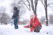 Leinwandbild Motiv Kids walk in the park first snow