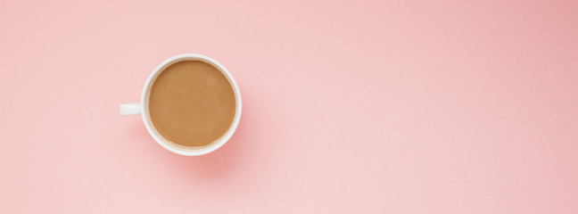 Cup of coffee with milk on pink background © dvoevnore
