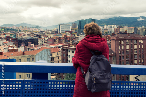 Foto Murales adult woman tourist looking at the Bilbao city from top