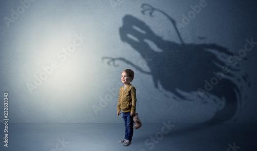 Leinwandbild Motiv Scary ghost shadow in a dark empty room with a cute blond child