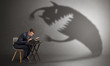 Leinwandbild Motiv Little hard worker afraid of scary monster shadow