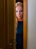Teenager is surprised to open a door. - 232640135