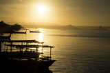 Talisay, Batangas, Philippines - December 25, 2015: Tourist Boat anchored at Lakeshore seen during sunrise that cater to interisland tourist travelers. Silhouettes - 232641301