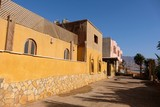 Old living house facade of traditional Arab architecture in Dahab, Sinai. - 232661395