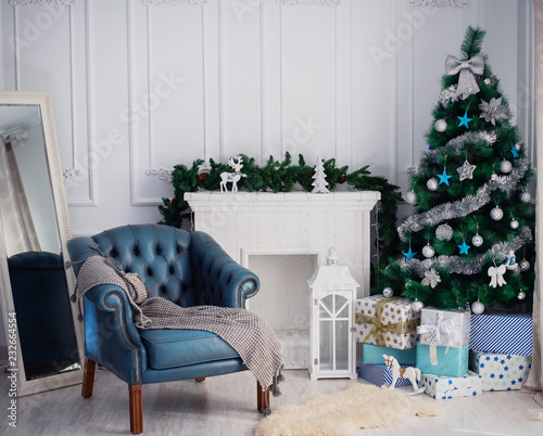 Room with a Christmas tree and fireplace