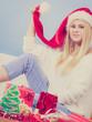 Woman wearing santa hat relaxing on sofa
