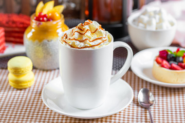 cup of coffee with whipped cream and dipping