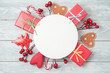 Christmas holiday background with gift boxes and decorations on wooden table