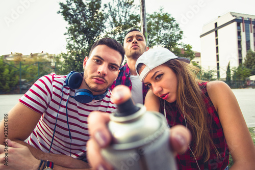 Young careless people hanging out outdoor