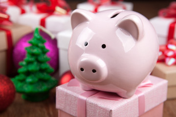 pink piggy bank with a Christmas tree and a pink gift box