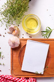Empty notebook for recipes with fresh herbs and spices - 232684174