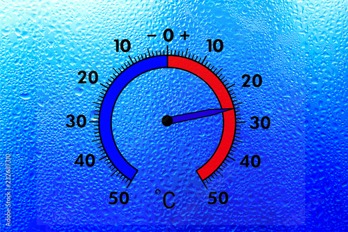 Leinwandbild Motiv The thermometer on the wet window shows plus 26 degrees celsius