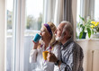 Elderly couple beside windows