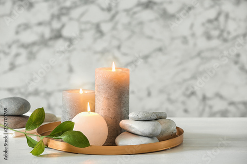 Leinwandbild Motiv Composition with spa stones and candles on table. Space for text