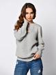 Leinwandbild Motiv Young beautiful woman posing in new casual grey blouse sweater