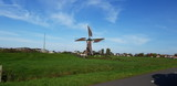 Old historical windmills in the Doespolder at Hoogmade in the Netherlands running with sails on its wings - 232711128