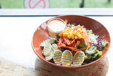 A bowl of salad healthy food on wooden table, Home made healthy food concept - 232734358
