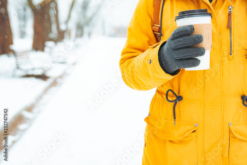 fototapeta na ścianę woman holding cup of coffee outside in winter day