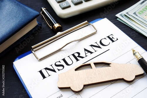 Wall mural Car insurance. Policy with pen and model.