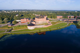 Hameenlinna fortress on the bank of the Vanayavesi lake in the solar July morning. Finland